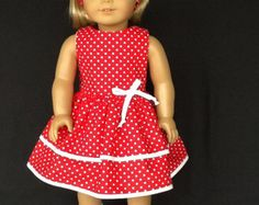 Your doll will be so dressed up on Valentines Day when she wears this dress.  I used a novelty print with a pink background and lots of cute puppies and hearts. The contrast is a pink print with tiny pink and white hearts.  The bodice is lined with self fabric and closes in the back with working buttons and buttonholes. It has gathered sleeves with elastic casing.  The contrast was used for the belt ties, the waistband, and bow trim.  All seams have been surged for a neat finish. Made in my…