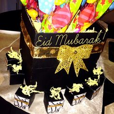 DIY Eid Mubarak Centerpiece with Candy Kabobs and little Eid Mubarak chocolate boxes....