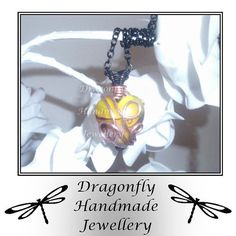 Wire wrapped yellow/white glass heart by DragonflyHJewellery