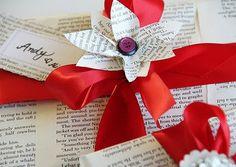 Book lover on your gift list?  Christmas wrapping from old falling apart books? Add a bow!