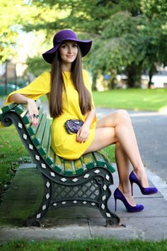 Look of the Day: Yellow and Purple by Galina Thomas. Yellow dress by Zara. Suede purple high heels by Christian Louboutin. Red sole. Purple hat. Purple beaded clutch bag by Karen Millen