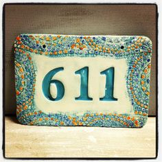 Hand crafted ceramic house number with vintage lace mosaic look border in sea foam green.
