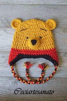 This is my take on a Winnie the Pooh inspired hat with Earflaps & Braids that Ive designed/crocheted. I hope find the time to crochet the whole Bonnet Crochet, Crochet Cap, Crochet Beanie, Cute Crochet, Crochet Crafts, Yarn Crafts, Crochet Projects, Crochet Animal Hats, Crochet Kids Hats