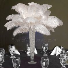 ostrich feather centerpieces, trumpet vases, #weddings, #waterbeads