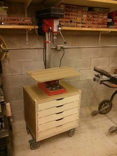This is a drill press cart I made using a cnc machine. Made with MDO, inch Baltic and MDF for table. Woodworking Drill Press, Woodworking Jigs, Woodworking Projects, Carpentry, Drill Press Stand, Drill Press Table, Tool Bench, Workshop Organization, Home Workshop