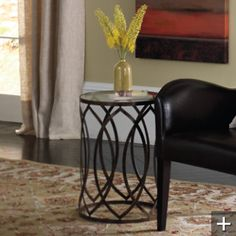 "Garner Steel Barrel Accent Table. 16"" diameter, hand applied brown finish, glass top. $149 @GR  16"" dia. x 22""H."