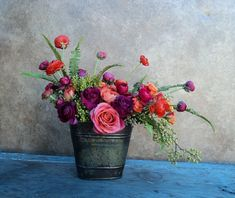 Flowers-ranunculus: love the bucket and range of red and purples