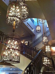 Birdcage lights. @Lindsey Bailey, an idea for your cool birdcage you never know what to do with.