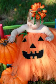 You should totally glue a pumpkin face on her Flower girl dress!!