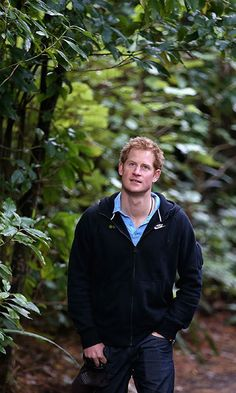Prince Harry grows beard, poses with baby rhinos in South Africa