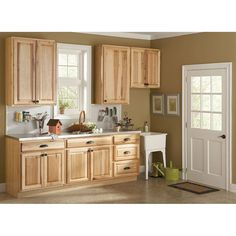 Hampton Bay 36x34.5x24 in. Hampton Sink Base Cabinet in Natural Hickory-KSB36-NHK at The Home Depot. Not bad with lighter splash, counter tops and dark pulls