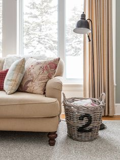 """Take the """"clutter basket"""" to the next level - get a pretty basket you can leave in plain sight and just toss a pretty throw blanket on top to hide the mess when guests come over!"""