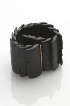Jacqueline Cullen - expanding whitby jet bracelet made from overlapping units, hand carved with embedded swarovski crystals on all leading edges, 18ct gold catch