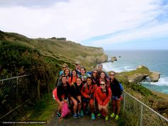 Some UD students at Tunnel Beach in New Zealand! They even brought Baby Blue along.