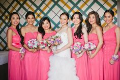 The bridesmaids wore coral chiffon dresses in various cuts and styles. | www.BridalBook.ph