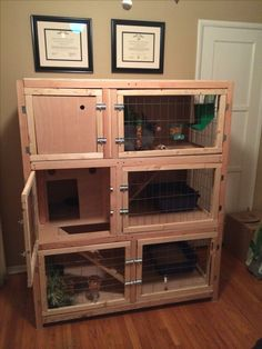 Homemade wooden three story rabbit hutch for multiple rabbits