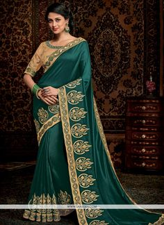 This delightful diva accoutre features unique styling and unusual material. Get the simplicity and grace with this green satin silk trendy saree. The lovely border and embroidered work throughout the . Trendy Sarees, Stylish Sarees, Fancy Sarees, Saris, Silk Sarees, Traditional Sarees, Traditional Fashion, Saree Draping Styles, Saree Styles