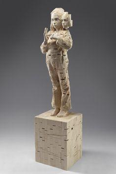 "funky creative sculpture: ""My headphones save my life"" by Gehard Demetz 2006; 158x38x35cm"