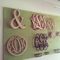 Working on organizing the workshop. We hung a peg board with hooks to organize the wooden monogram order and custom laser cut wood.