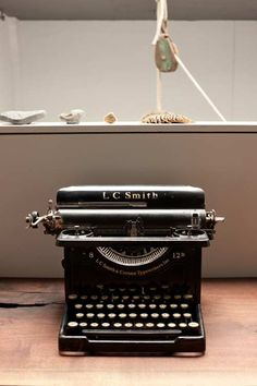 "Design*Sponge SNEAK PEEK - Greg and Grey of Antler&Co; -  ""One of Grey's beautiful typewriters, from her extensive collection, with a large functioning pulley in the background."""