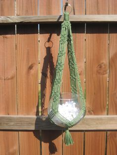 """Handmade 32"""" Macrame Plant Hanger made with 4mm braided Macrame cord. I have many colors available to choose from. This listing is for the color Cactus. This color has been discontinued by the manufacturer so only what I have made will be available.. All listings I have posted are already made unless otherwise specified. The plant hanger measures 32"""" from the top of the ring to the bottom of the tassel without the pot. If you need a larger or smaller size please email me.(planter or bowl not…"""