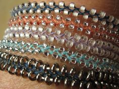 Stacked Beaded Bracelets; basic braid with added beads. Very nice.