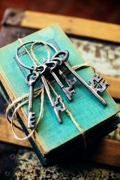 Decorating with Books Ideas | Small touches such as worn books and keys can help carry an antique ...