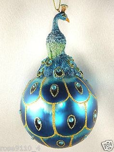One of my favorite but fragile peacock ornaments   (I have 2 of these) hanging from dinning room chandelier