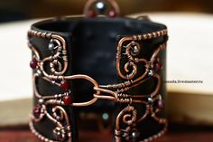 """""""Black Royal Lily"""" Copper, pearls, agate, leather 
