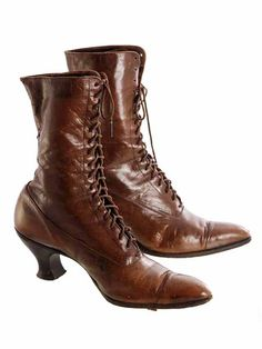 """Another great pair of wearable history, this pair of antique mahogany brown womens leather boots have pointed toes and sturdy stacked wood Louis or """"spool"""" heels, and leather soles. The laces are orig"""