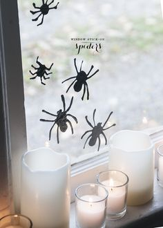 Halloween DIY // window cling spiders with puff paint