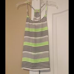 J Crew racer back tank top J Crew racer back tank top size 6 (small) that is lime green, black, and white strips in different widths. J. Crew Tops Tank Tops