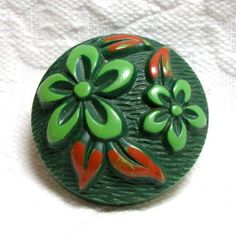 BIG VINTAGE GREEN CELLULOID BUTTON w/SPEARMINT & ORANGE BUFFED FLOWERS