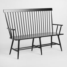 Boasting solid wood construction and a black finish, our bench expands on traditional Windsor chair design with a high cap-railed spindle back and armrests. A fantastic value, this versatile bench is ideal pulled up to the dining table, or as accent seating in the entryway.