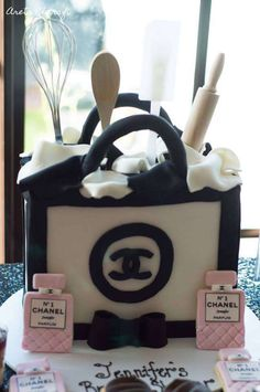 Cake and cookies at a Chanel bridal shower party! See more party ideas at CatchMyParty.com!
