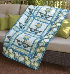 """""""Pots of Posies"""" by Mischele Hart and machine quilted by Susan Scheer. Uses A Mum for A Mum by Jackie Robinson for Benartex. Featured in Fons & Porter's Love of Quilting Magazine, January/February 2016 . 