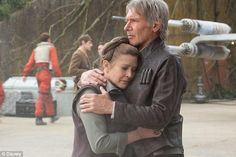 Reunited: Carrie Fisher, seen with co-star Harrison Ford in 2015's Star Wars: The Force Aw...
