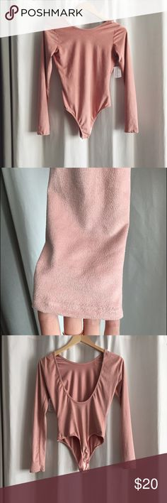 Pink suede bodysuit NWT Windsor faux suede long sleeve bodysuit with low scoop back. Color is sort of a pinkish nude. Size small WINDSOR Tops