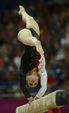 Canada's Victoria Moors performs on the balance beam during the women's gymnastics qualification at the London 2012 Olympic Games