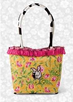 Samantha Tote in Sunny Bunnie by Cowbunnies. $30.00. Soft handle, so comfortable when you put it over your shoulder.. And of course the Cowbunnie - coming and going on every bag, replete with her fluffy tail!. Featured in Cooking with Paula Deen!. Fine designer fabrics and materials!. Exquisite trims, custom designed from around the globe.. A veritable floral garden on your arm. Trimmed in hot pink taffeta ribbon, the final touch is most definitely the sweet little r...