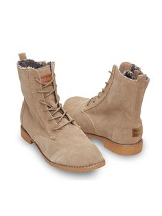 The warm shearling lining of TOMS women's Taupe Suede Alpa Boots is as delightful as winter's first snow fall.