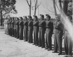 Flight Nurses and enlisted technicians of the 803rd Medical Air Evacuation Squadron, stand in formation after receiving the Air Medal during a ceremony at Ledo, Assam, India. 27 March 1945 ~