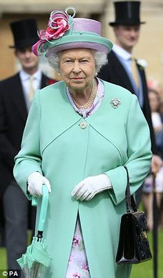 Colour match: The monarch colour-coordinated herKarl Ludwig Couture coat dress to her Philip Somerville hat