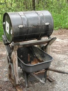 DIY – Compost Tumbler Honey, next project for your list! We can use up those extra casters and lumber we found when we cleaned up the garage. I like that you can put a wheelbarrow underneath the compost bin. Compost Diy, Diy Compost Tumbler, Garden Compost, Compost Barrel, Making Compost, Composting Toilet, Garden Projects, Wood Projects, Garden Tools