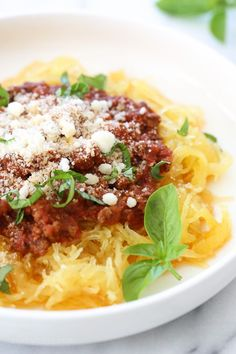 Make this easy, healthy Spaghetti Squash AND Meat Sauce all at the same time with this delicious one-pot meal ready in under thirty minutes when made in the pressure cooker or slow cooker! This is the easiest way to make spaghetti squash whole, no cutting before it's cooked, just poke some holes all over and cook it!