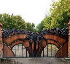 AWESOME CUSTOM MADE IRON ENTRANCE GATES WITH INTRICATE WOODEN HORSE HEADS CARVED IN WOOD!