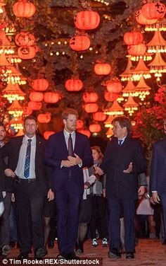Harry chatted to Tivoli CEO Lars Liebst (pictured to the right of Harry)