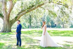 First Look Under a Live Oak | Colorful Old Wide Awake Plantation Wedding by Charleston wedding photographer Dana Cubbage Weddings