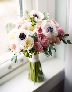 Somewhere I heard anemones will be in season in Feb.  And they're pretty and clean looking.  Could do something like this with the other flowers in light pink or green or just more white.