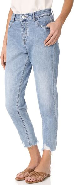 DL1961 Goldie High Rise Tapered Jeans by DL1961  DL1961 Goldie High Rise Tapered Jeans by DL1961  Available Colors: Plunge  Available Sizes: 25 26 28 29 30 31 32  DetailsHigh-waisted DL1961 jeans in a relaxed tapered profile. Raw cuffs and shredded holes accentuate the retro feel. 5-pocket styling. Button fly.  Fabric: Lightweight denim.  100% cotton.  Wash cold or dry clean.  Imported Pakistan.  Measurements  Rise: 11in / 28cm  Inseam: 26.5in / 67cm  Leg opening: 12.5in / 32cm  Measurements…